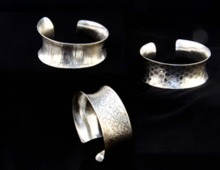 Sterling silver, anticlastic forming, hammer textured and roller embossed
